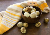 Quail eggs on wooden background — Stock Photo