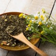 Dry herbal tea on plate — Stock Photo