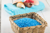 Sea salt in bowl on wooden background — Stock Photo