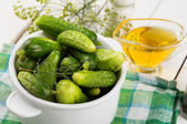 Fresh cucumbers on wooden background — Stock Photo