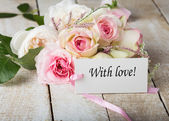 Postcard with elegant flowers and tag — Stock Photo