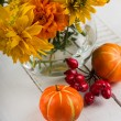 Autumn flowers on table — Stock Photo