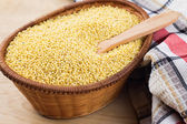 Millet in bowl — Stock Photo