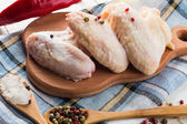 Fresh chicken on wooden table — Stock Photo