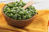 Frozen peas in bucket — Stock Photo