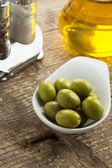 Green olive in bowl — Stock Photo