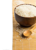 Rice in wooden bowl — Stock Photo