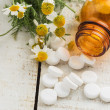 Herbs and bottle with medicines. Concept homeopathy. — Stock Photo #32075331