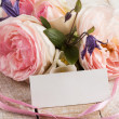 Elegant flowers and empty tag for your text — Stock Photo