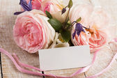 Elegant flowers and empty tag for your text — Stok fotoğraf