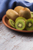 Fresh kiwi on plate — Stock Photo
