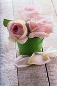 Postcard withpastel roses in little bucket — Stock Photo