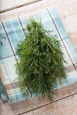 Fresh dill on towel on table — Stock Photo