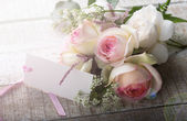 Postcard with elegant flowers and empty tag for your text — 图库照片