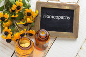 Herbs and bottle with medicines. Concept homeopathy. — Stock Photo