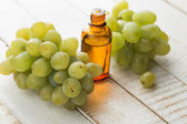 Grape and grape seed oil — Stock Photo
