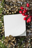 Decorative christmas composition and note — Stock Photo