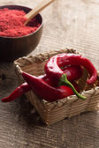 Fresh and dry chili peppers — Stock Photo