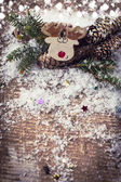 Decorative christmas composition on wooden background — Stock Photo