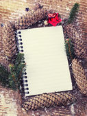 Christmas decorations and empty notebook — Stock Photo