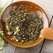 Stock Photo: Dry herbal tea on plate