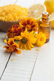 Essential aroma oil ,sea salt, flowers and lemon — Stock Photo
