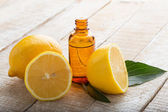 Aroma oil with lemons — Stock Photo