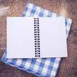 Open empty notebook on wooden background — 图库照片
