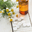 Concept homeopathy. Bottle with medicines, pills, herb. — Stock Photo #36558267