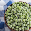Frozen peas in bowl — Stock Photo
