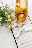 Concept homeopathy. Bottles with medicines and natural herbs. — Stock Photo
