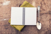 Open empty notebook with spoon — 图库照片