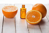 Essential aroma oil with orange — Stock Photo