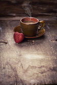 Cup of coffee and red heart — Stock Photo