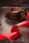 Cup of coffee and ribbon — Stock Photo
