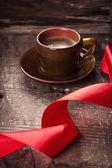 Cup of coffee and ribbon — Zdjęcie stockowe