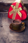 Cup of coffee and present — Stock Photo