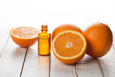Essential aroma oil with oranges — Stock Photo