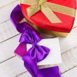 Stock Photo: Festive gift boxes on wooden background