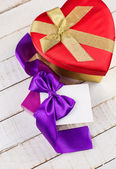 Festive gift boxes on wooden background — Stock Photo