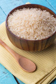 Raw rice in wooden bowl — Stock Photo