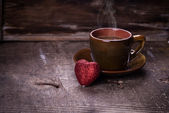 Cup of coffee with heart decoration — Stock Photo