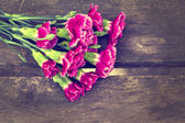 Fresh flowers on wooden background — Stock Photo