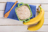 Oat flakes in bowl with banana — Stock Photo
