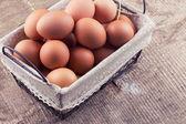 Fresh eggs on wooden background — Stock Photo