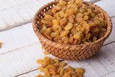 Raisins on wooden background — Stock Photo