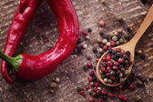 Mixed pepper and chilli  on wooden background — Stock Photo
