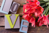 Flowers and word love — Stok fotoğraf