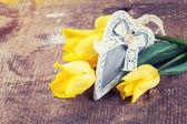Fresh yellow flowers and decorative heart — Stock Photo