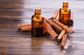 Essential aroma oil with cinnamon — Stock Photo